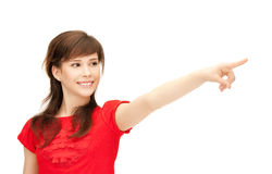 Teenage girl pointing her finger Stock Photography