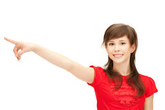 Teenage girl pointing her finger stock image