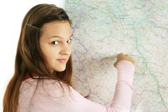 Teenage girl pointing at map Stock Image