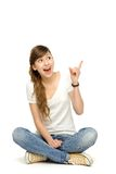 Teenage girl pointing up Royalty Free Stock Photos