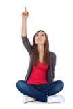 Teenage girl pointing up Stock Image