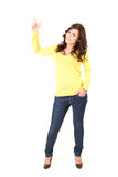 Teenage girl pointing up, full length, Royalty Free Stock Photography