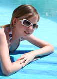 Teenage girl by pool. Girl teenager relaxing by a pool stock image