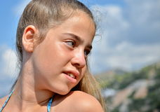 Teenage girl by the pool Stock Photos