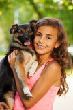 Teenage girl portrait in hugging little dog Royalty Free Stock Images