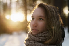 Teenage girl portrait in winter pine forest is sunset royalty free stock images