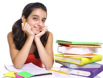 Teenage girl posing for the camera near her books Royalty Free Stock Images