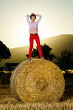 Teenage girl posing at the evening on haystack, sunset colors Stock Photos