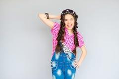 Teenage girl posing on gray background Stock Photo