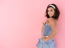 Teenage girl posing over pink background smiling Royalty Free Stock Photo
