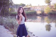 Teenage girl posing in the park notes Royalty Free Stock Photo