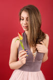 Teenage girl posing with tulip Stock Image