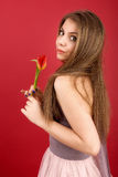 Teenage girl posing with tulip Royalty Free Stock Photos