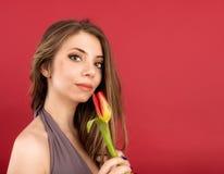 Teenage girl posing with tulip Stock Photos