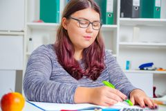 Teenage girl preparing for exams. Teenage girl doing homework for school Royalty Free Stock Photography