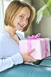 Teenage girl with present Stock Images