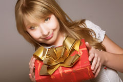 Teenage girl with present box Stock Photo