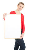 Teenage girl presenting something on blank placard Stock Image
