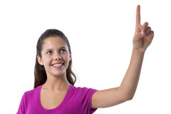 Teenage girl pressing an invisible virtual screen. Against white background royalty free stock photography