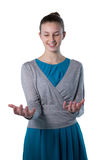 Teenage girl pretending to hold invisible object Stock Photos