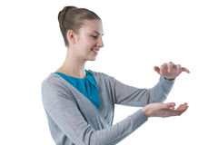 Teenage girl pretending to hold invisible object Royalty Free Stock Photos
