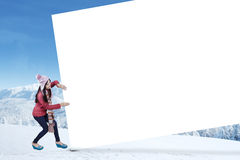 Teenage girl pull billboard at mountain Royalty Free Stock Image