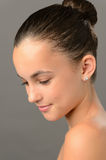 Teenage girl purity skin beauty looking down. Teenage girl purity  skin beauty face looking down on gray Stock Photos