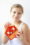 teenage girl putting coins in her moneybox Royalty Free Stock Photos