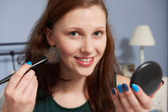 Teenage Girl Putting On Make Up Stock Images