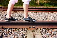 Teenage Girl on Rail Stock Photo