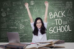 Teenage girl raising hands in the class Royalty Free Stock Photo