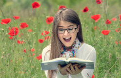 Teenage girl read a book Stock Images
