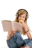Teenage girl reading stock image