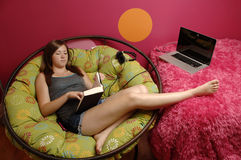 Teenage girl reading Stock Images