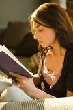 Teenage girl reading book Royalty Free Stock Photos
