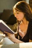 Teenage girl reading book royalty free stock photos
