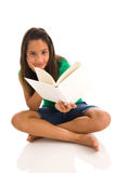 Teenage girl reading a book Royalty Free Stock Image