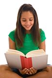Teenage girl reading a book Royalty Free Stock Photography
