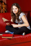 Teenage girl reading at home Stock Photo