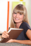 Teenage girl reading at home Stock Photography