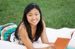 Teenage Girl Reading Outdoors Stock Photos