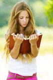 Teenage girl reading red book Royalty Free Stock Image