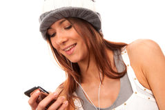 Teenage girl reading text message on cell phone Royalty Free Stock Photography