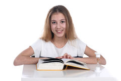 Teenage girl reading on a white background Royalty Free Stock Photos