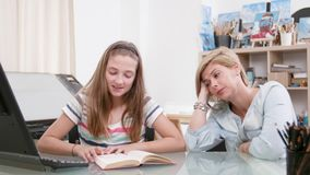 Teenage girl reads a text to her mother as she listens carefully stock video footage