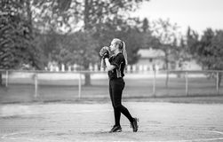 Teenage girl ready to pitch a fastball Stock Images