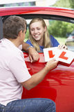 Teenage Girl Receiving Her Learner Plates.  stock image