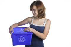 Teenage girl with a recycling basket Stock Photo