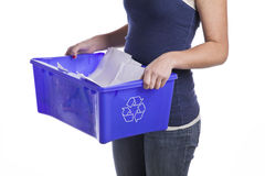 Teenage girl with a recycling basket Stock Photography
