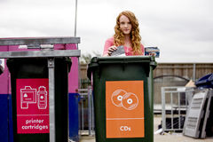 A teenage girl recycling cds royalty free stock photos